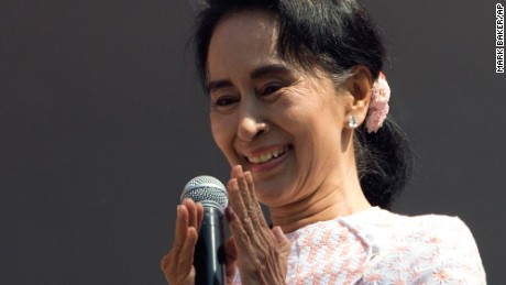 Leader of the National League for Democracy party Aung San Suu Kyi delivers a speech from a balcony of the NLD headquarters in Yangon on November 9.