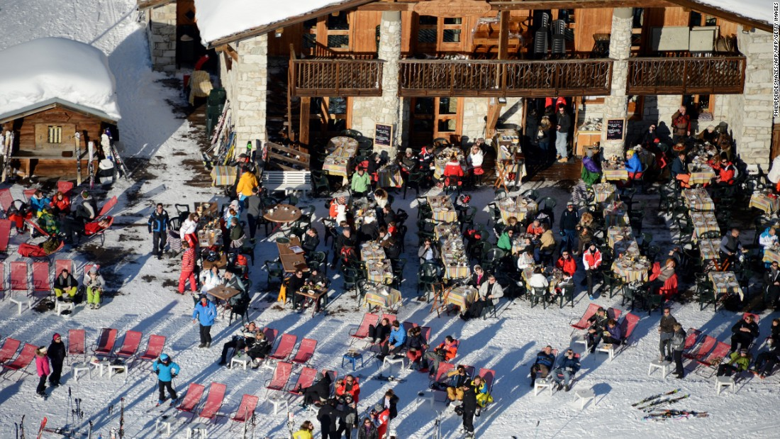 Skiers enjoy the winter sunshine at a restaurant in the French resort of Val d'Isere.