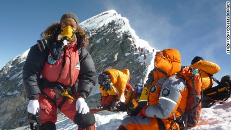 "Nepalese mountaineer Pemba Dorje Sherpa (L) and others pause at the Hillary Step while pushing for the summit of Everest on May 19, 2009. from the south face of Nepal.    Bad weather conditions forced three Nepalese Sherpa brothers to give up their plans to set a new world record by spending 24 hours in the ""death zone"" on top of Mount Everest. Pemba Dorje Sherpa, 30, and his two younger brothers reached the summit on May 19, but were forced down after only two hours, Pemba told AFP after returning to Kathmandu.      AFP PHOTO/COURTESY OF PEMBA DORJE SHERPA (Photo credit should read STR/AFP/Getty Images)"