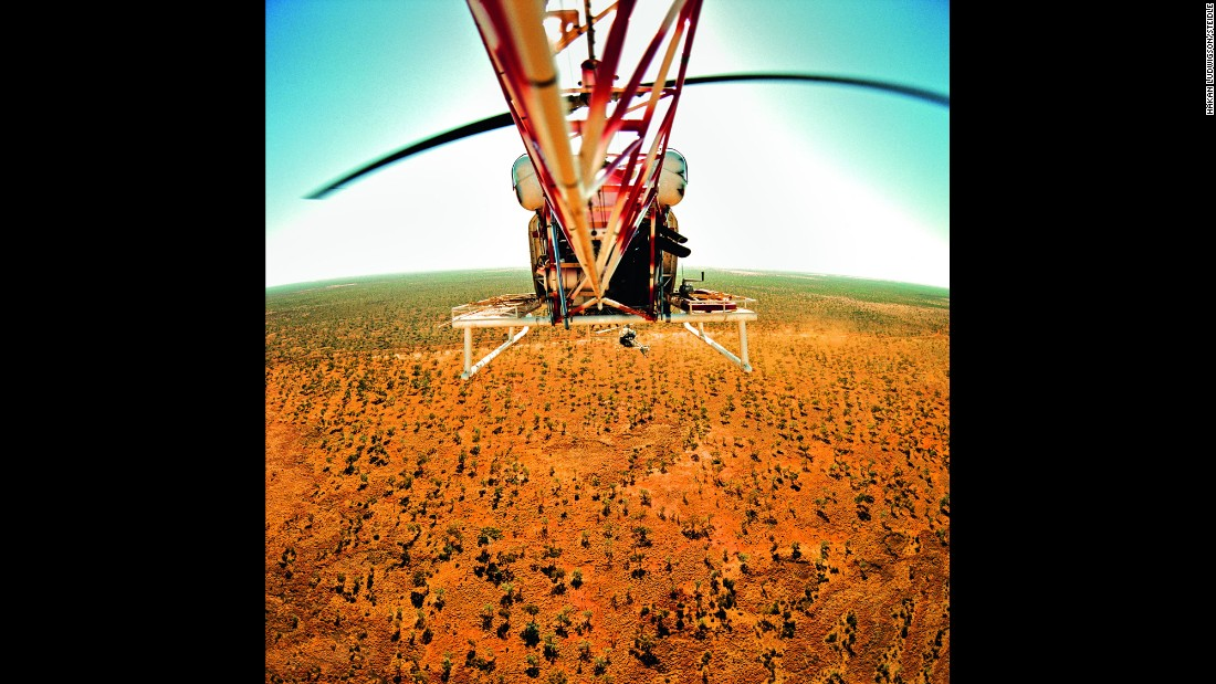 """Heli-mustering,"" or herding from the air, is one way of keep cattle in line. These herders in Killarney, Northern Territory, stuck a fishing rod out of the helicopter because from the air, it is possible to spot seabass in the nearby rivers and swoop by for a quick catch. <strong> </strong>"
