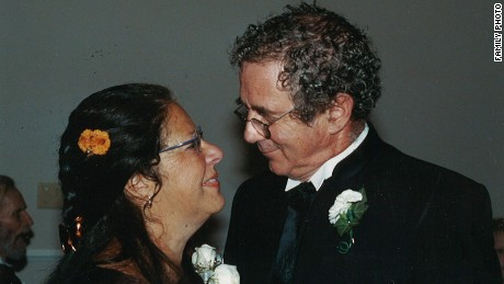 Carlo Russo, years before his ALS diagnosis, smiles with wife Karen.