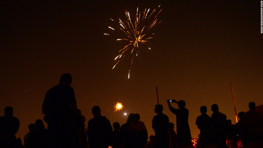 Athletes watch fireworks at the Madan Mohan Malviya Stadium in Allahabad, India, on November 10.