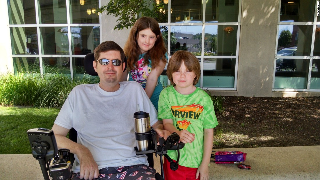 "Masters sits with Sabrina and Radley in June 2015.  ""The ALS Association told us you have to stay in front of this disease. Don't wait until it's an emergency,"" he says. ""We've done some voice banking.  I'm using feet on my laptop and when they quit working I'll need the <a href=""http://alsassistivetechnology.blogspot.com/2013/09/electronic-eye-gaze-communication.html"" target=""_blank"">eye gaze machine </a>or <a href=""http://www.controlbionics.com/"" target=""_blank"">NeuroSwitch</a>. Denial is going to get you in trouble. You have to be proactive and have the next stage of tools ready when you need them."""