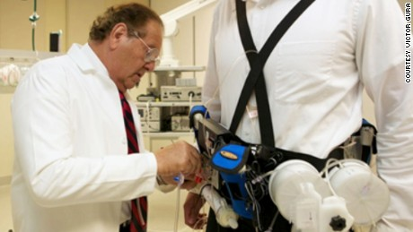 "Victor Gura fits a ""wearable artificial kidney,"" which filters a patient's blood continuously."