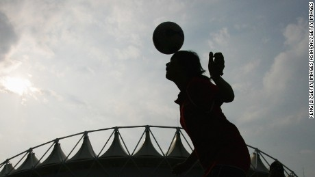 WUHAN, HUBEI - SEPTEMBER 22:  A Chinese girl goes up for a header before  the quarter final match of FIFA Women's World Cup China 2007 at Wuhan Sports Center Stadium on September 22, 2007 in Wuhan, China.  (Photo by Feng Li/Getty Images)