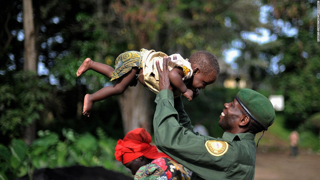 A park ranger at Virunga National Park smiles at his 9-month-old daughter.