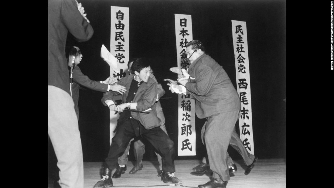 Seventeen-year-old Otoya Yamaguchi  uses a foot-long sword to fatally stab Japan Socialist Party leader Inejiro  Asanuma on a stage in Tokyo on October 12, 1960. Yamaguchi was upset with Asanuma's support of a U.S.-Japan mutual defense treaty. Photographer Yasushi Nagao, was the first non-American photographer to win a Pulitzer Prize, in 1961. Nagao used a 4x5 Speed Graphic loaded with a Kodak film pack and equipped with an electronic flash unit. He had shot 11 of the film pack's frames and was awaiting the conclusion of the political speeches when Yamaguchi stabbed Asanuma, who staggered across the stage before Yamaguchi stabbed him a second time. Nagao focused at 15 feet and made the picture on the final frame of the film pack. It was the last Pulitzer Prize photo made with a 4x5, large format camera. Nagao used a 127mm lens.