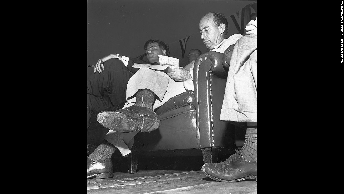"Democratic U.S. presidential nominee Adlai Stevenson, wearing a right shoe with a hole in its sole, takes notes before a campaign speech in Flint, Michigan, on September 1, 1952. Seeing the hole, Flint Journal photographer Bill Gallagher tried to discreetly photograph the moment and avoid being noticed by his competitors. He casually placed ""his camera at arm's length on the floor of the stage, looked the other way, and popped his flash,"" said Buell. When Gallagher won the Pulitzer Prize in 1953, Stevenson wired the photographer, ""Glad to hear you won with a hole in one.""  Gallagher used a 4x5 Speed Graphic to make this picture. The film holder was loaded with 4x5 Kodak cut film. Lens was 127mm, aperture unknown."