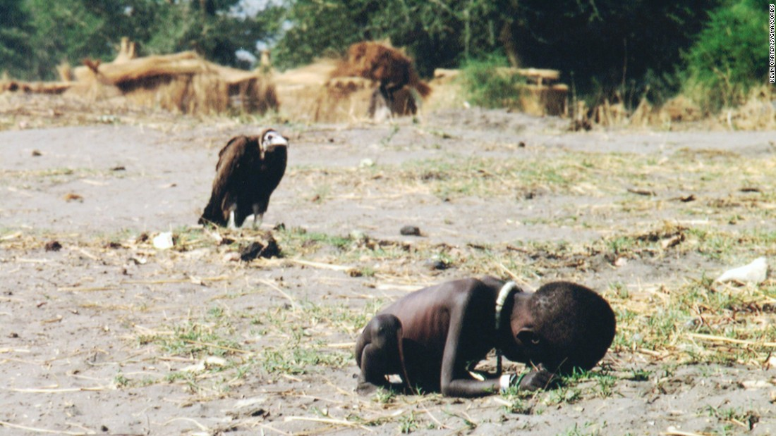 Kevin Carter, another member of the Bang Bang Club, was a South African photographer who traveled to Sudan to cover the devastating famine there. Outside a feeding station, Carter discovered a starving baby girl and a nearby vulture waiting for her to die. Carter shot the image with a Nikon camera loaded with Fujichrome film and outfitted with a 180mm lens. Exposure is unknown. Carter killed himself in July 1994, a month after he received the Pulitzer for this photograph.