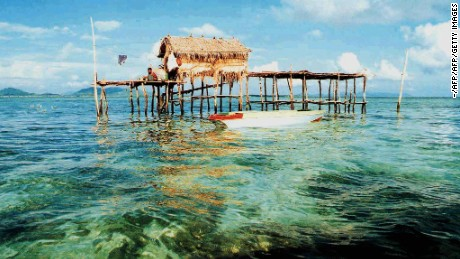 One of the many sea-huts is seen in the waters near Sipadan Island, 14 April 2001, in Malaysia's eastern Sabah state. The huts are inhabited by locals, many of whom have Filipino relatives, who harvest the abundance sea weed for a living.