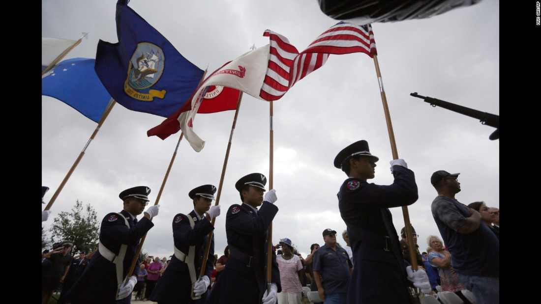 A color guard presents the flags during a Veterans Day observance in San Antonio.