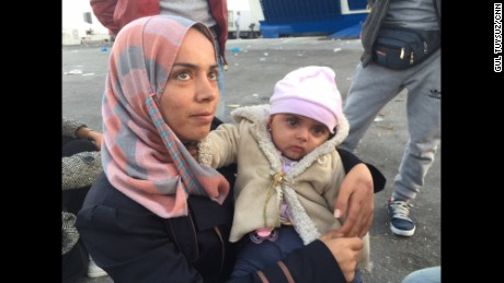 Refugees wait for a boat to a new life