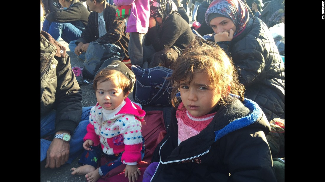 Emine and Wahibe, aged 2.5 and 4, respectively, are sisters from Aleppo, Syria. They are waiting with their parents for the boat to take them to Athens.