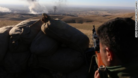"Iraqi Kurdish forces take part in an operation backed by US-led strikes in the northern Iraqi town of Sinjar on November 12, 2015, to retake the town from the Islamic State group and cut a key supply line to Syria. The autonomous Kurdish region's security council said up to 7,500 Kurdish fighters would take part in the operation, which aims to retake Sinjar ""and establish a significant buffer zone to protect the (town) and its inhabitants from incoming artillery."" AFP PHOTO / SAFIN HAMED        (Photo credit should read SAFIN HAMED/AFP/Getty Images)"