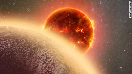 """This artist's conception made by Dana Berry of SkyWorks and provided by NASA on Nov. 6, 2015 shows GJ 1132b, foreground, a rocky planet similar to the Earth in size and mass, orbiting a red dwarf star. The planet is 39 light-years away - within the atmospheric study range of the Hubble Space Telescope. """"If we find this pretty hot planet has managed to hang onto its atmosphere over the billions of years it's been around, that bodes well for the long-term goal of studying cooler planets that could have life,"""" said Massachusetts Institute of Technology's Zachory Berta-Thompson. (Dana Berry/SkyWorks/NASA via AP)"""