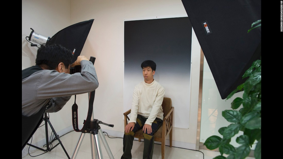A boy has his photo taken at the Hyowon Healing Center. After participants arrive, their portraits are taken in the same style as photos found on the coffins of dead people, Huguier said.
