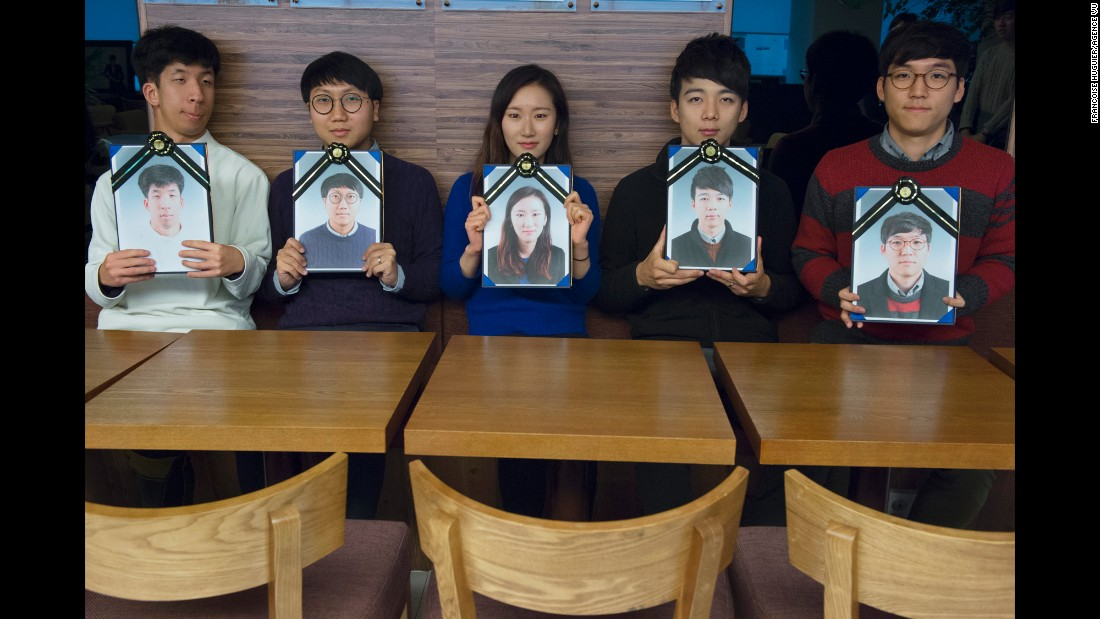 Participants pose with their funeral portraits.