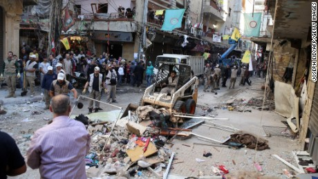 Lebanese municipality workers clear debris from the site of a twin bombing attack in the area of Burj al-Barajneh in Beirut's southern suburb on November 13, 2015. Lebanon mourned 44 people killed in south Beirut in a twin bombing claimed by the Islamic State group, the bloodiest such attack in years, the Red Cross also said at least 239 people were also wounded, several in critical condition. AFP PHOTO/JOSEPH EID        (Photo credit should read JOSEPH EID/AFP/Getty Images)