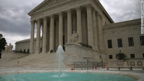 A fountain flows in front of the Supreme Court Building, August 20, 2014 in Washington, DC.