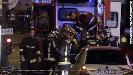 An injured man is put into an ambulance following an attack in the 10th arrondissement of the French capital Paris,on November 13, 2015. At least 18 people were killed as multiple shootings and explosions hit Paris, police said. Police also said there was an ongoing hostage crisis in the Bataclan a concert hall in the French capital. AFP PHOTO / KENZO TRIBOUILLARDKENZO TRIBOUILLARD/AFP/Getty Images