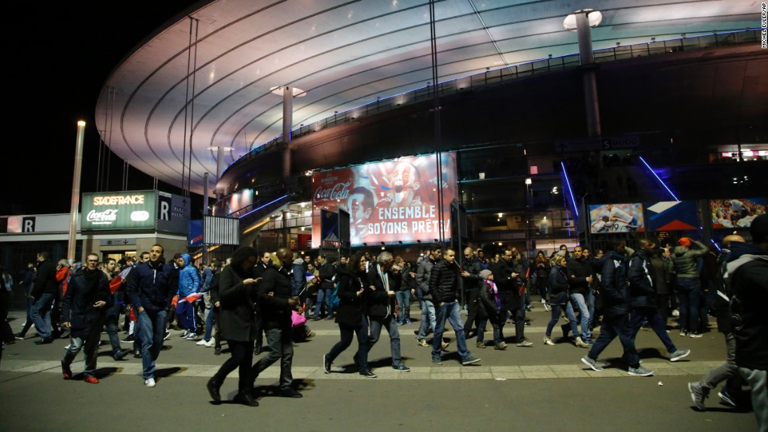 People leave the Stade de France after explosions were heard near the stadium during a  soccer match between France and Germany on Friday. Paris Deputy Mayor Patrick Klugman told CNN President Francois Hollande was at the match and was evacuated at halftime.
