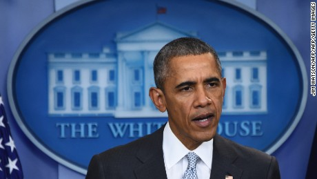 US President Barack Obama speaks to the press in Washington, DC on November 13, 2015, after being informed about a series of deadly attacks that rocked Paris. At least 35 people were killed as multiple shootings and explosions hit Paris, police said. Police also said there was an ongoing hostage crisis in the Bataclan a concert hall in the French capital.AFP PHOTO/ JIM WATSONJIM WATSON/AFP/Getty Images
