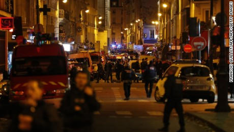 Police forces, firefighters and rescue workers secure the area near the Bataclan concert hall in central Paris, early on Saturday, November 14.