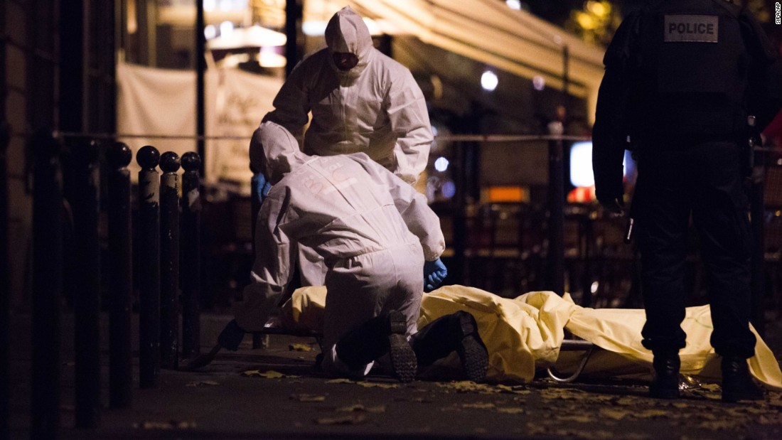 "Forensics are working in the street of Paris after the terrorist attack on Friday, November 13.  The words ""horror,"" ""massacre"" and ""war"" peppered the front pages of the country's newspapers, conveying the shell-shocked mood."