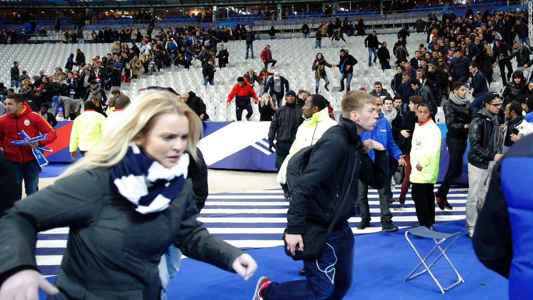 Spectators invade the pitch of the Stade de France stadium after the international friendly soccer match between France and Germany in Saint-Denis.