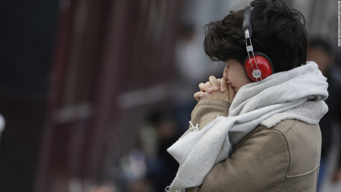 A woman mourns outside Le Carillon bar in the 10th district of Paris on November 14. The attackers ruthlessly sought out soft targets where people were getting their weekends underway.