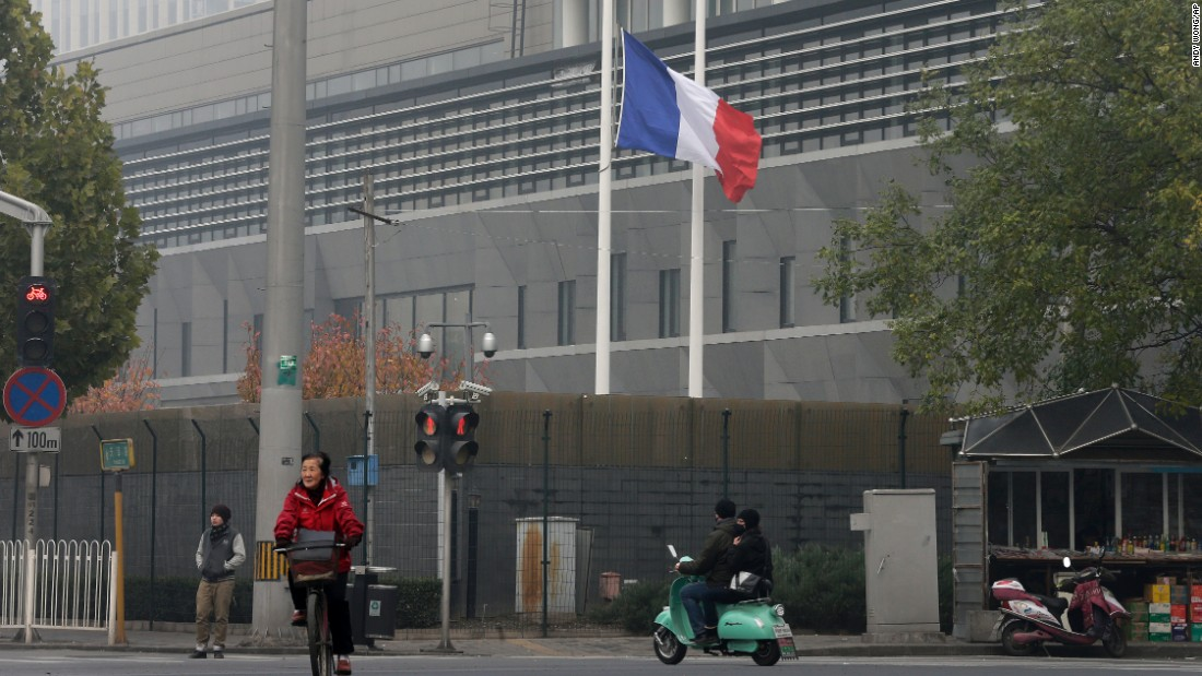 The French national flag flutters at half-staff on November 14 at its embassy in Beijing.
