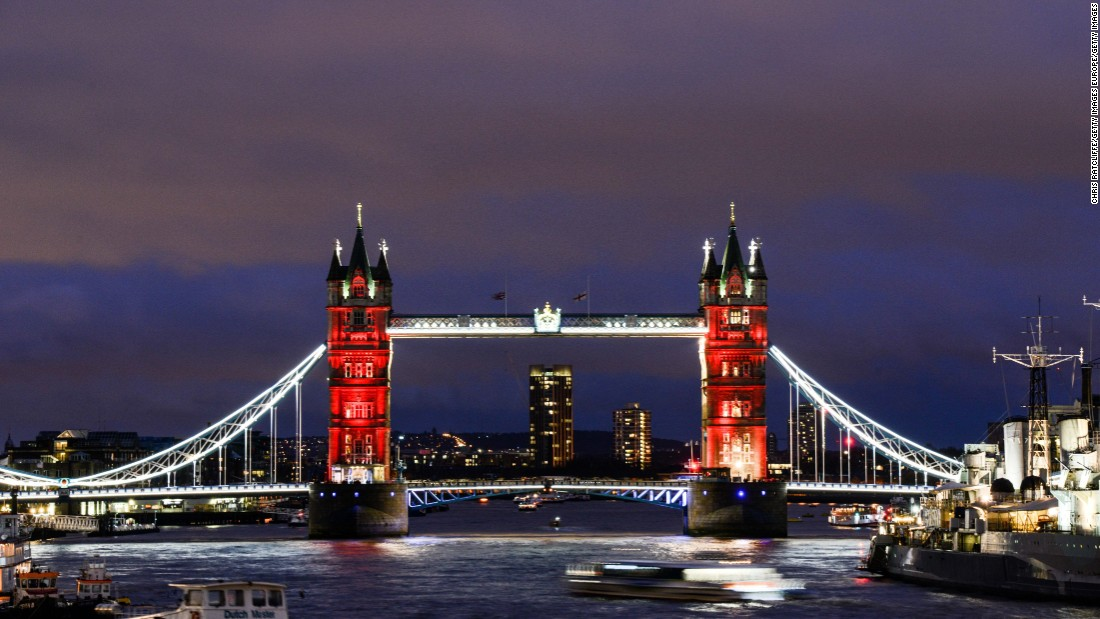 As the sun sets, London's Tower Bridge is lit in a succession of blue, white and red on November 14.