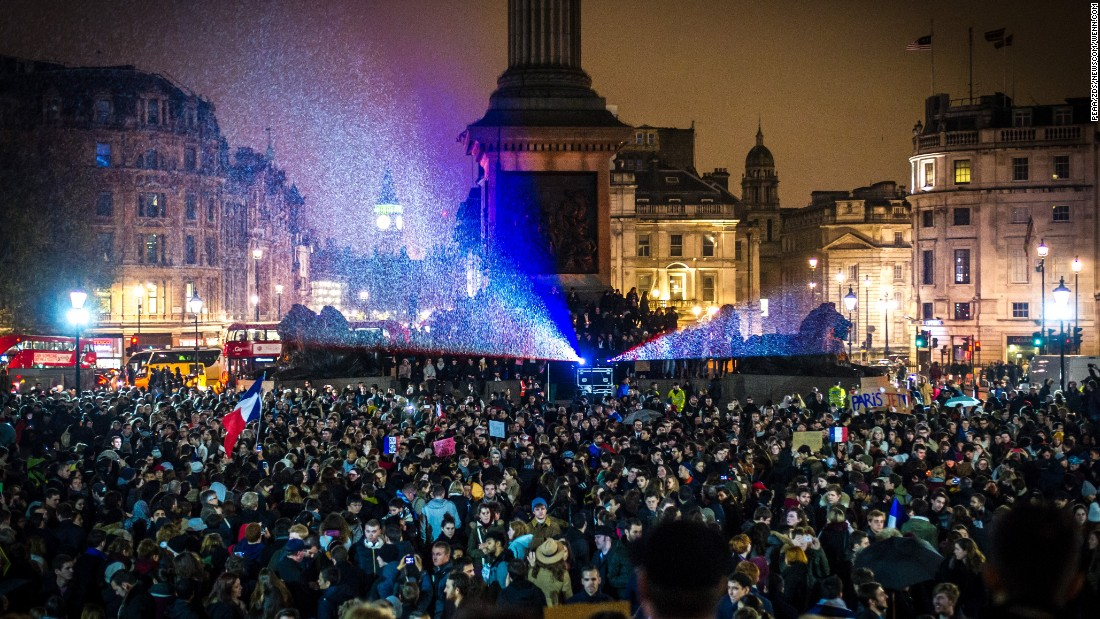 Thousands gather in London's Trafalgar Square for a candlelit vigil on November 14 to honor the victims of the Paris attacks.