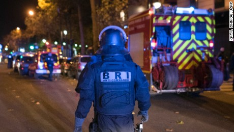 An elite police officer arrivesoutside the Bataclan theater  in Paris, France, Wednesday, Nov. 13, 2015. Several dozen people were killed in a series of unprecedented attacks around Paris on Friday, French President Francois Hollande said, announcing that he was closing the country's borders and declaring a state of emergency. (AP Photo/Kamil Zihnioglu)