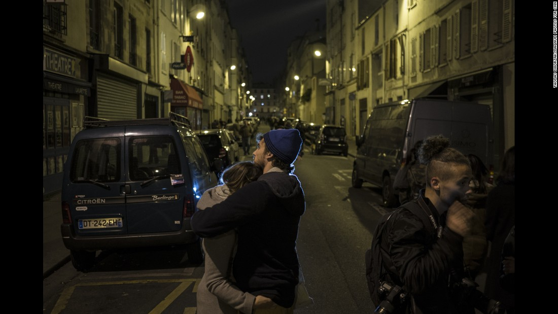 A couple embraces in the streets of Paris on November 14. The world has rallied around France.