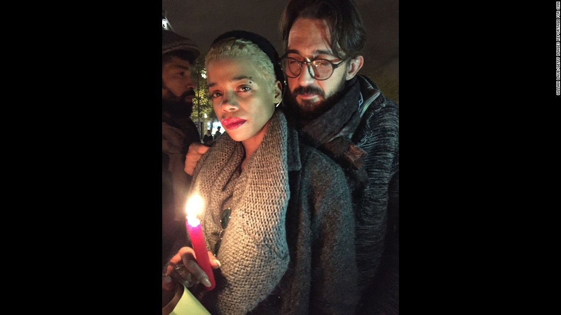 "Vigils are being held across Paris in the aftermath of the terror attacks that took more than 125 lives on Friday, November 13. Photographer <a href=""http://www.gillianlaub.com/"" target=""_blank"">Gillian Laub</a> met people who were out honoring the victims and reflecting on the tragedy the next day. Among them were 30-year-old Paquita Mboni, left, and Laurent Farre, 40, at the Place de la Republique square. ""In the United States I don't know if this would have happened,"" Farre said. ""People would have been able to defend themselves because they are allowed to carry guns. We aren't, so we are defenseless. But we won't give in to fear. It's not an option."""