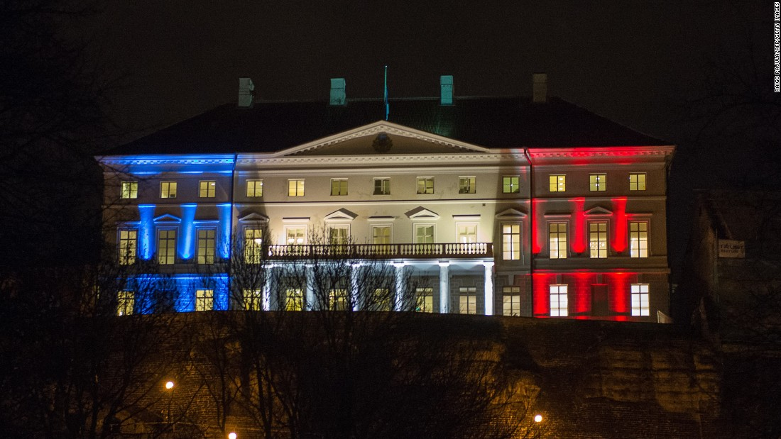 Estonia's government building in Tallinn glows with the French national colors on November 14.