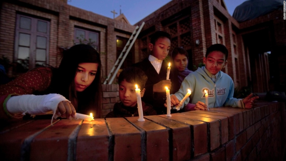 People pray during a candlelight vigil for victims of the Paris attacks at a church in Islamabad, Pakistan, on November 15.