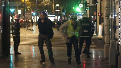 People run as panic spreads at the Place de la Republique square in Paris, on November 15, 2015, two days after a series of deadly attacks. Islamic State jihadists claimed a series of coordinated attacks by gunmen and suicide bombers in Paris that killed at least 129 people in scenes of carnage at a concert hall, restaurants and the national stadium.   AFP PHOTO / KENZO TRIBOUILLARDKENZO TRIBOUILLARD/AFP/Getty Images