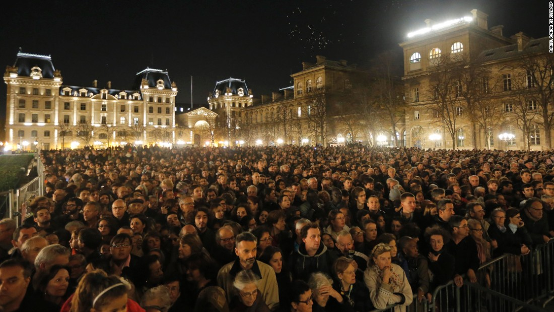 People gather outside Notre Dame Cathedral in Paris on November 15 for a national service for the victims of the city's terror attacks.
