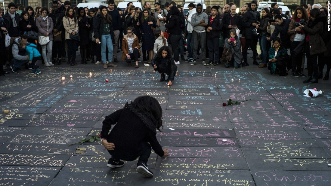 People write messages on the ground at Place de la Republique in Paris on November 15.
