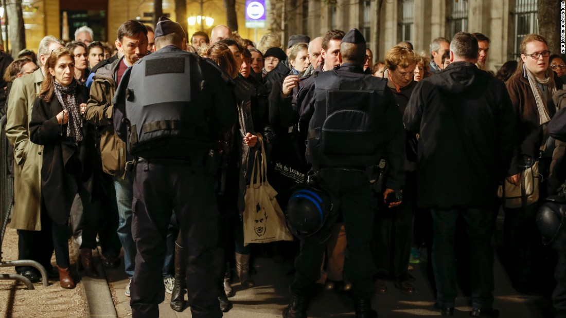 People go through a security checkpoint to attend a Mass in homage to victims of the Paris terror attacks at Notre Dame cathedral in Paris on Sunday, November 15. French President Francois Hollande declared a state of emergency after the attacks in Paris on Friday, November 13, and said border security has been ramped up. The terrorist group ISIS claimed responsibility for the attacks.