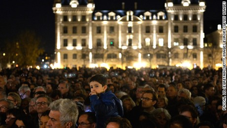 PARIS, FRANCE - NOVEMBER 15:  People gather outside Notre Dame Cathedral ahead of a ceremony to the victims of the Friday's terrorist attacks on November 15, 2015 in Paris, France. As France observes three days of national mourning members of the public continue to pay tribute to the victims of Friday's deadly attacks. A special service for the families of the victims and survivors is to be held at Paris.'  (Photo by Pascal Le Segretain/Getty Images)