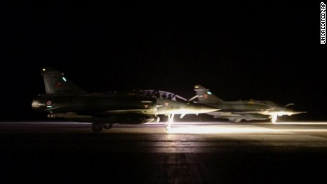"This image made from video released by the French Army Communications Audiovisual office (ECPAD) shows French army jets taking off from a site in Jordan to strike at Islamic State group targets Sunday, Nov. 15, 2015. France launched ""massive"" air strikes on the Islamic State group's de-facto capital in Syria Sunday night, destroying a jihadi training camp and a munitions dump in the city of Raqqa, where Iraqi intelligence officials say the attacks on Paris were planned. (ECPAD/APTN via AP) THIS IMAGE MAY ONLY BE USED FOR 30 DAYS FROM TIME TRANSMISSION; NO ARCHIVING; NO LICENSING; MANDATORY CREDIT"