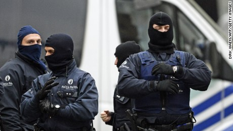 Heavily armed special forces stand guard outside a house being searched in the Rue Delaunoy in  Brussels on November 16, 2015. During the weekend searches were carried out and multiple people were arrested in relation to Friday's terrorist attacks in Paris. Several terrorist attacks in Paris, France, have left at least 129 dead and 350 injured. Most people were killed during a concert in venue Bataclan, the other targets were a restaurant and a soccer game. The attacks have been claimed by Islamic State.