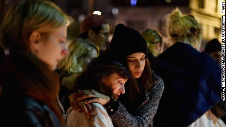 PARIS, FRANCE - NOVEMBER 16:  Members of the public view candles and tributes left opposite the main entrance of Bataclan concert hall as French police lift the cordon following Fridays terrorist attacks on November 16, 2015 in Paris, France. A Europe-wide one-minute silence was held at 12pm CET today in honour of at least 129 people who were killed last Friday in a series of terror attacks in the French capital.  (Photo by Jeff J Mitchell/Getty Images)