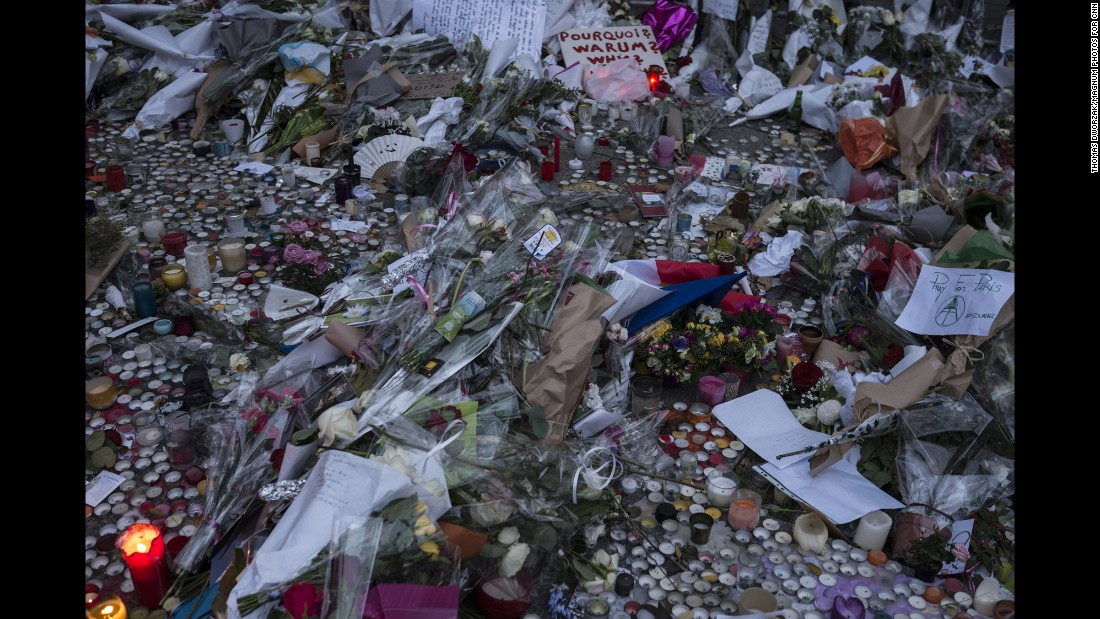 A memorial commemorates the victims of the Paris attacks on a street in Paris on Monday, November 16.