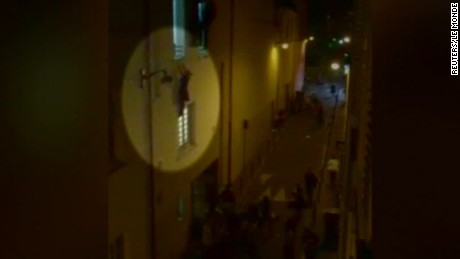 paris attacks woman hanging from window ledge cooper dnt ac _00002405.jpg