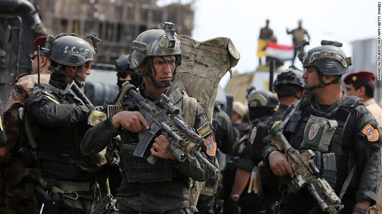 Iraqi counter-terrorism forces patrol a street in Tikrit.
