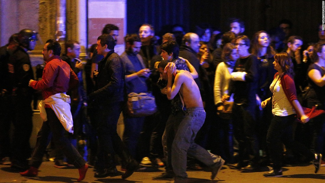 "Wounded people are helped outside the Bataclan concert hall in Paris following a series of coordinated attacks in the city on Friday, November 13. The militant group ISIS claimed responsibility <a href=""http://www.cnn.com/2015/11/13/world/gallery/paris-attacks/index.html"" target=""_blank"">for the attacks,</a> which killed at least 130 people and wounded hundreds more."
